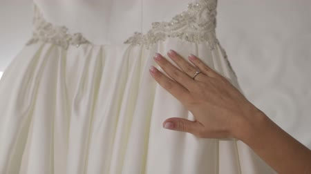 preparált : Hand of beautiful bride touches wedding dress. Pretty and well-groomed woman. Wedding morning. Slow motion