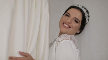 preparált : Beautiful and lovely bride in night gown and veil near wedding dress. Pretty and well-groomed woman. Wedding morning. Slow motion