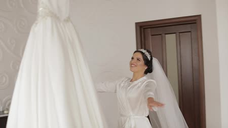 preparált : Beautiful and lovely bride in night gown and veil running to wedding dress. Pretty and well-groomed woman. Wedding morning. Slow motion