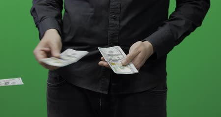 оплаченный : Giving money green screen. Give money cash, receive payment concept. Mans hand hold cash money and give them to woman. Dollar bills in the hand isolated at green background Стоковые видеозаписи