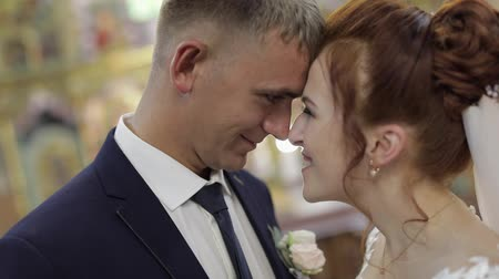фехтование : Elegant bride and groom together in an old church. Wedding couple. Happy family. Slow motion