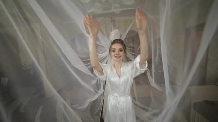 hand : Beautiful and lovely bride in night gown under huge veil. Pretty and well-groomed woman. Wedding morning. Slow motion