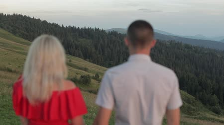 romantik : Lovely couple together near mountains. Relationship and love. Slow motion Stok Video