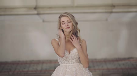 hajú : Beautiful and lovely bride. Pretty and well-groomed woman. Blonde. Wedding day. Slow motion