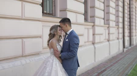 nevěsta : Wedding couple. Lovely groom and bride. Happy family. Man and woman in love. Wedding day. Slow motion