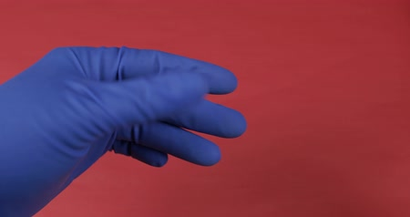 addiction recovery : Doctor hand dressed in blue medical glove gives blister with pills to a woman and receive payment in american dollar bills. Concept of medicine and health improvement. Corruption in the Medical Sphere Stock Footage