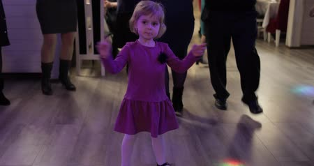 dances : Little child dance in the patry. Feel happy, smiling. Girl having fun on disco. Stock Footage