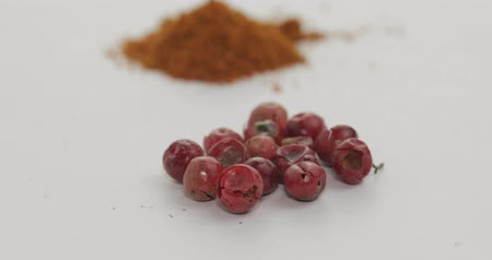 mirchi : Red pepper powder rotation footage video. Red herbal spice, aromatic seasoning for food preparation and cooking, macro shot against a white background