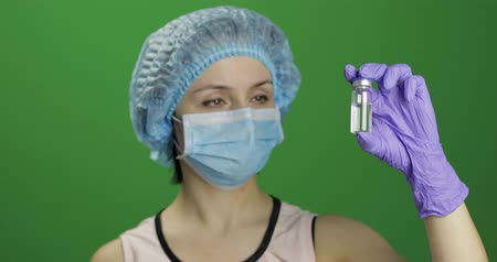 сущность : Female scientist holding ampoule in hand, new medication developing, vaccination. Concept of medicine and health improvement. Chroma key background. Green screen