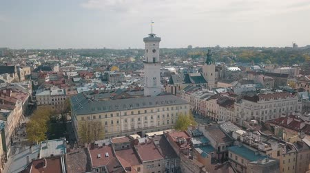 guildhall : Aerial Roofs and streets Old City Lviv, Ukraine. Central part of old city. European City in spring. Densely populated areas of the city. Panorama of the ancient town. Town Hall, Ratush. Drone shot Stock Footage