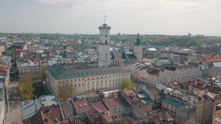 çatılar : Aerial Roofs and streets Old City Lviv, Ukraine. Central part of old city. European City in spring. Densely populated areas of the city. Panorama of the ancient town. Town Hall, Ratush. Drone shot Stok Video