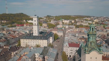 guildhall : Aerial Roofs and streets Old City Lviv, Ukraine. Central part of old city. European City. Panorama of the ancient town. City Council, Town Hall, Ratush, old church Lviv Latin Cathedral. Drone shot