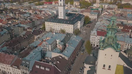 guildhall : Aerial Roofs and streets Old City Lviv, Ukraine. Central part of old city. European City. Panorama of the ancient town. City Council, Town Hall, Ratush. Tram rides on the road. Drone shot