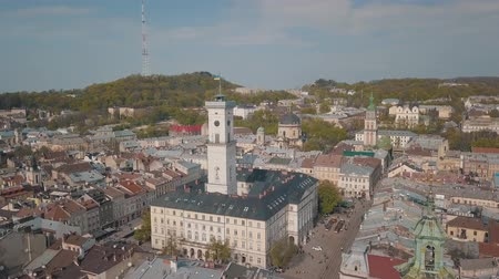 kelet európa : Aerial Roofs and streets Old City Lviv, Ukraine. Central part of old city. European City. Panorama of the ancient town. City Council, Town Hall, Ratush, old church Lviv Latin Cathedral. Drone shot