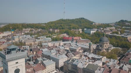dominicano : Aerial Roofs and streets Old City Lviv, Ukraine. Central part of old city. European City in spring. Populated areas of the city. Panorama of the ancient town. Town Hall, Ukraine Dominican. Drone shot Vídeos