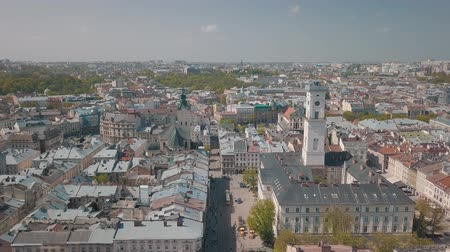dominican : Aerial Roofs and streets Old City Lviv, Ukraine. Central part of old city. European City in spring. Densely populated areas of the city. Panorama of the ancient town. Town Hall, Ratush. Drone shot Stock Footage