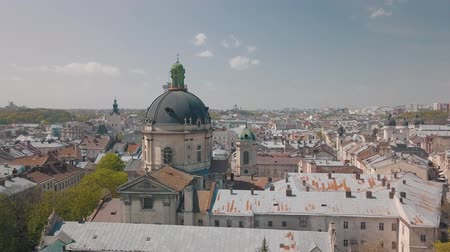 dominican : Aerial Roofs and streets Old City Lviv, Ukraine. Central part of old city. European City in spring. Populated areas of the city. Panorama of the ancient town. Town Hall, Ukraine Dominican. Drone shot Stock Footage