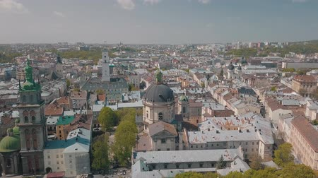 guildhall : Aerial Roofs and streets Old City Lviv, Ukraine. Central part of old city. European City in spring. Populated areas of the city. Panorama of the ancient town. Town Hall, Ukraine Dominican. Drone shot Stock Footage