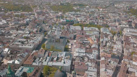 városháza : Lvov, Ukraine. Aerial Roofs and streets old city Lviv. Central part of old city. European city in spring. Panorama of the ancient town. Town Hall, Council, Ukraine Dominican Church. Drone shot
