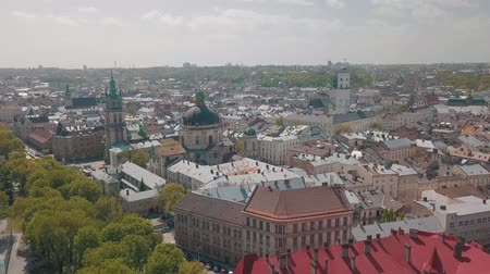 galice : Lvov, Ukraine. Aerial Roofs and streets old city Lviv. Central part of old city. European city in spring. Panorama of the ancient town. Town Hall, Council, Ukraine Dominican Church. Drone shot