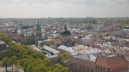 kelet európa : Lvov, Ukraine. Aerial Roofs and streets old city Lviv. Central part of old city. European city in spring. Panorama of the ancient town. Town Hall, Council, Ukraine Dominican Church. Drone shot
