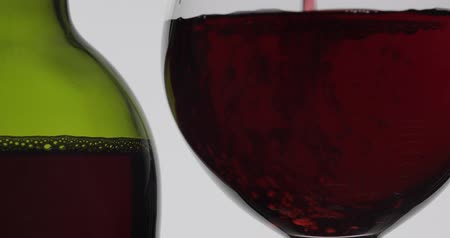 カベルネ : Wine. Red wine pouring in wine glass over white background. Rose wine, red juice pour into a glass. Close up shot