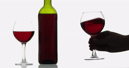 каберне : Glass with rose wine in womans hand. Wine glass with red wine against white background. Cheers