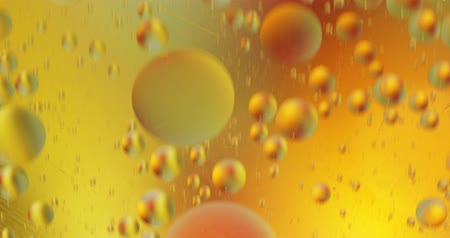 Fantastic structure of colorful bubbles. Chaotic motion. Abstract colorful paint. Top view. Movement of bubbles in the liquid. Oil surface multicolored background. Macro 影像素材