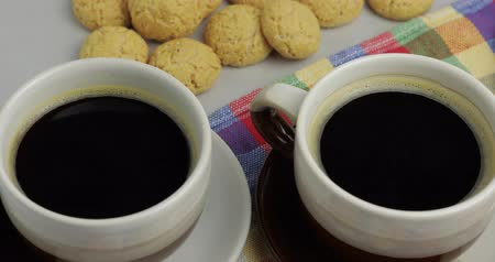 aveia : Cookie and two cups of coffee. Kruidnoten, pepernoten, traditional sweets, strooigoed