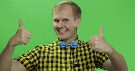 sincerely : Caucasian fashionable man show thumbs up. Guy in yellow shirt. Chroma key. Few shots Stock Footage