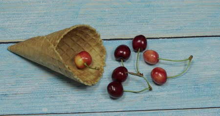 sorbete : Berry season. Berry ice cream. Berries of cherry in a waffle on a blue wooden background