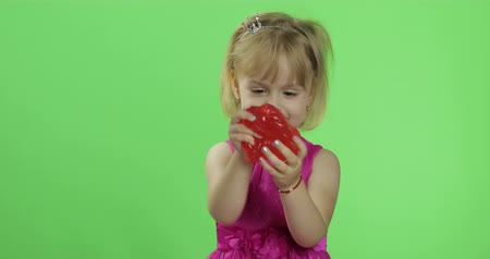 goop : Child having fun making red slime. Kid playing with hand made toy slime. Funny kid girl. Relax and Satisfaction. Oddly satisfying blue slime for pure fun and stress relief. Green screen. Chroma Key