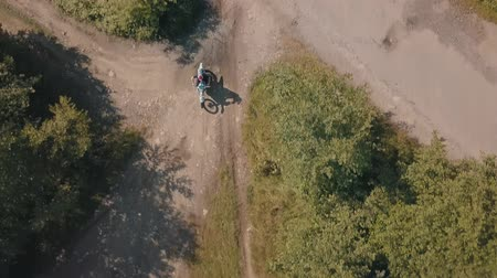 motorcross : Extreme motorcyclist rides from road to the open field. Motocross. Motosport. Stock footage of motorcycle. Aerial view Stockvideo