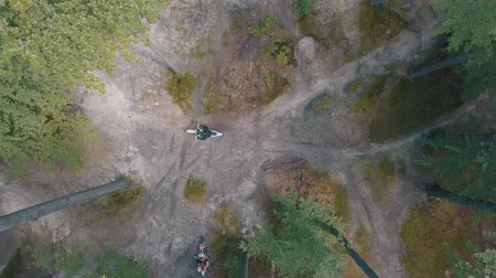 motorcross : Extreme motorcyclists rides on the forest roads. Motocross. Motosport. Stock footage of motorcycle. Aerial view Stockvideo