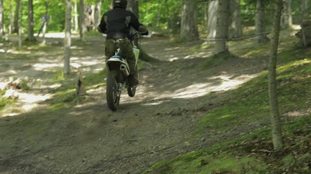motorcross : Extreme motorcyclist rides on the forest roads. Motocross. Motosport. Stock footage of motorcycle. Slow motion