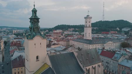 religia : Aerial roofs and streets Old City Lviv, Ukraine. Central part of old european city in morning. Panorama of the ancient town. City Council, Town Hall, Ratush, old Latin Cathedral Church. Drone shot