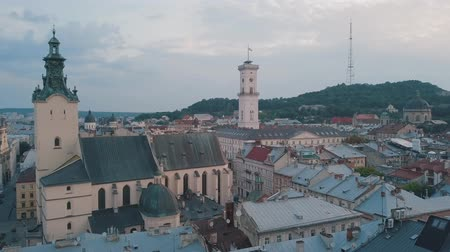 guildhall : Aerial roofs and streets Old City Lviv, Ukraine. Central part of old european city in morning. Panorama of the ancient town. City Council, Town Hall, Ratush, old Latin Cathedral Church. Drone shot