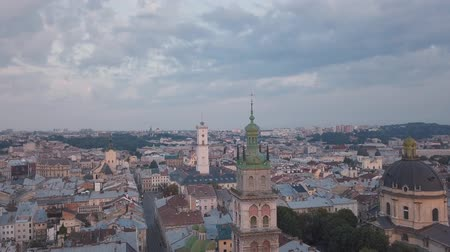 galice : Aerial roofs and streets Old City Lviv, Ukraine. Central part of old european city in morning. Panorama of the ancient town. City Council, Town Hall, old Dominican Church. Drone shot