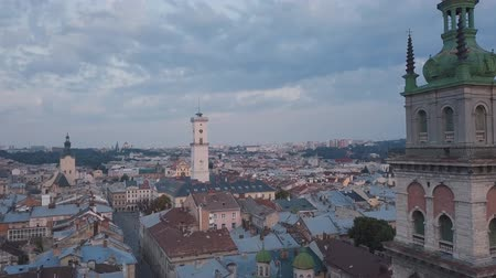 városháza : Aerial roofs and streets Old City Lviv, Ukraine. Central part of old european city in morning. Panorama of the ancient town. City Council, Town Hall, Ratush, old church. Drone shot