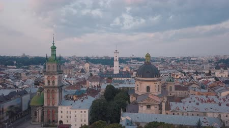 kelet európa : Aerial roofs and streets Old City Lviv, Ukraine. Central part of old european city in morning. Panorama of the ancient town. City Council, Town Hall, old Dominican Church. Drone shot