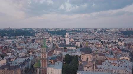 városháza : Aerial roofs and streets Old City Lviv, Ukraine. Central part of old european city in morning. Panorama of the ancient town. City Council, Town Hall, old Dominican Church. Drone shot