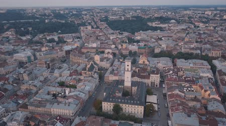 kelet : Aerial roofs and streets Old City Lviv, Ukraine. Central part of old european city in morning time. Panorama of the ancient town. City Council, Town Hall, Ratush. Drone shot