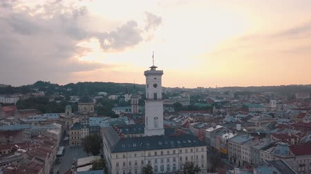 ukraine : Aerial roofs and streets Old City Lviv, Ukraine. Central part of old european city in morning time. Panorama of the ancient town. City Council, Town Hall, Ratush. Drone shot