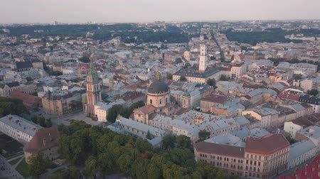 lviv : Aerial roofs and streets Old City Lviv, Ukraine. Central part of old european city in morning. Panorama of the ancient town. City Council, Town Hall, old Dominican Church. Drone shot