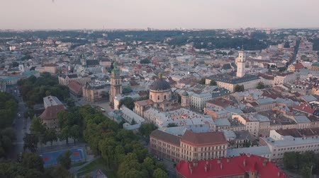 guildhall : Aerial roofs and streets Old City Lviv, Ukraine. Central part of old european city in morning. Panorama of the ancient town. City Council, Town Hall, old Dominican Church. Drone shot