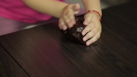 goop : Child hands having fun with brown slime. Kid playing with hand made toy slime. Funny kid girl. Relax and Satisfaction. Oddly satisfying blue slime for pure fun and stress relief. Dark background Stock Footage