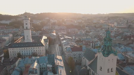 kelet európa : Aerial roofs and streets Old City Lviv, Ukraine. Central part of old european city in morning time. Panorama of the ancient town. City Council, Town Hall, Ratush. Drone shot