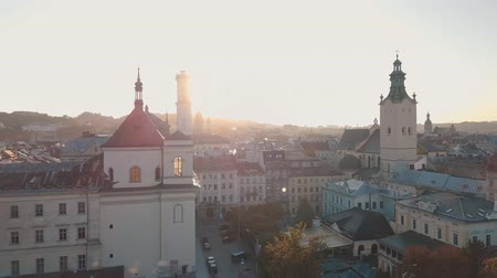 guildhall : Aerial roofs and streets Old City Lviv, Ukraine. Central part of old european city in morning time. Panorama of the ancient town. City Council, Town Hall, Ratush. Drone shot