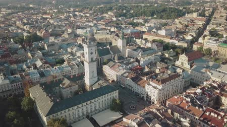 lviv : Aerial roofs and streets Old City Lviv, Ukraine. Central part of old european city in morning time. Panorama of the ancient town. City Council, Town Hall, Ratush. Drone shot
