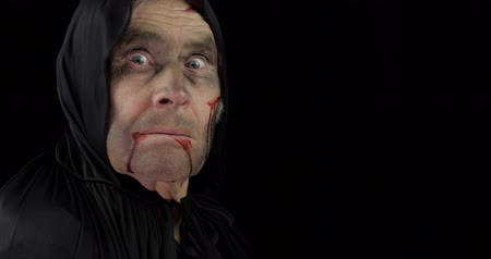 zombi : Old executioner Halloween man portrait. Elderly man with dripping blood on his face. Executioner, headman makeup. Fashion art design. Attractive model in Halloween costume. Black background